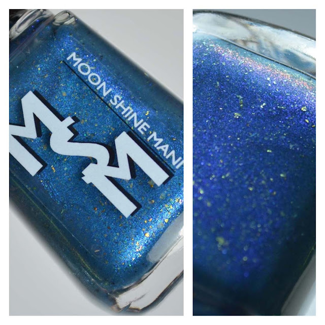 smoky blue nail polish with color shifting flakies in a bottle