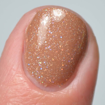 light brown holo nail polish close up swatch