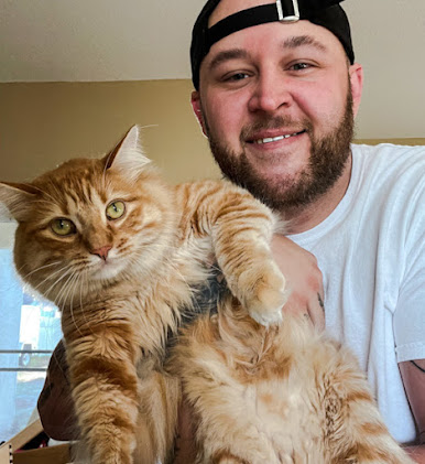 Ginger tabby helps guy recover from drug addiction