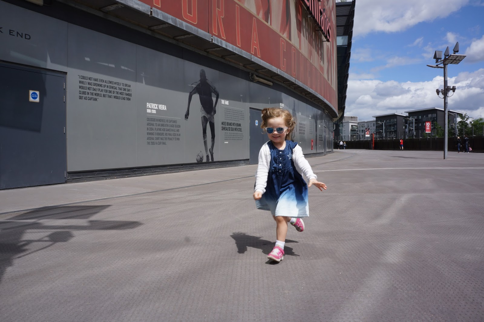 toddler girl running outside emirates stadium
