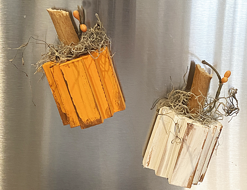 pumpkin magnets on the refrigerator