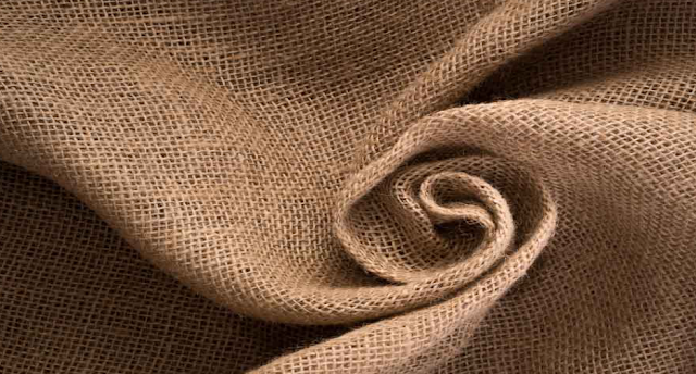 The flax plant gives us which fabric?
