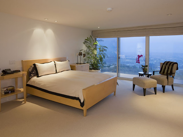 Picture of modern minimalist bedroom with wooden bed and the city views