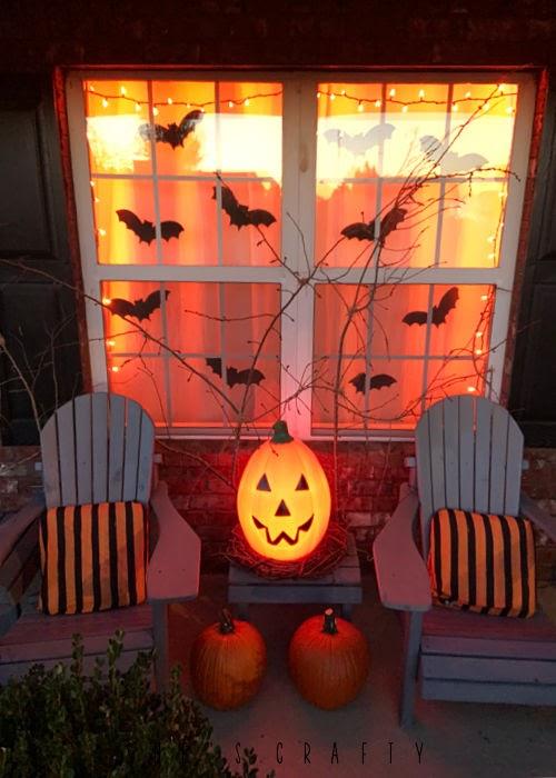 Halloween porch with orange lights at night