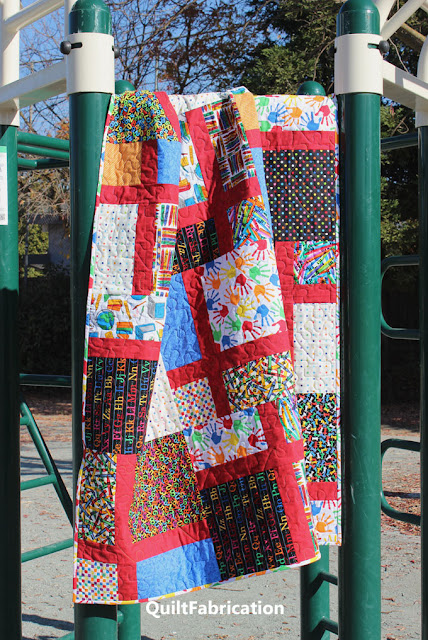 school themed quilt hanging in the playground
