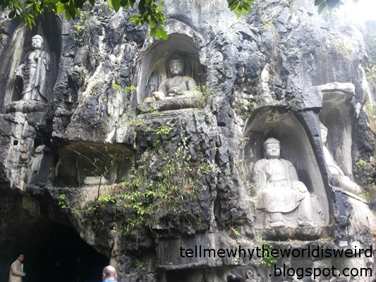 Ancient Buddhist statues carved into a rock wall