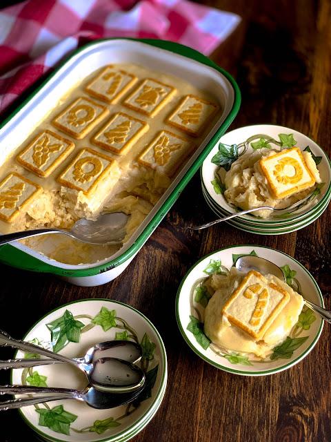 Pineapple Pudding, creamy, velvety homemade custard pudding layered between Pepperidge Farm Butter Cookies, classic southern.  Simply scrumptious, the Christmas Chessmen add a charming touch to the dessert during the holidays.