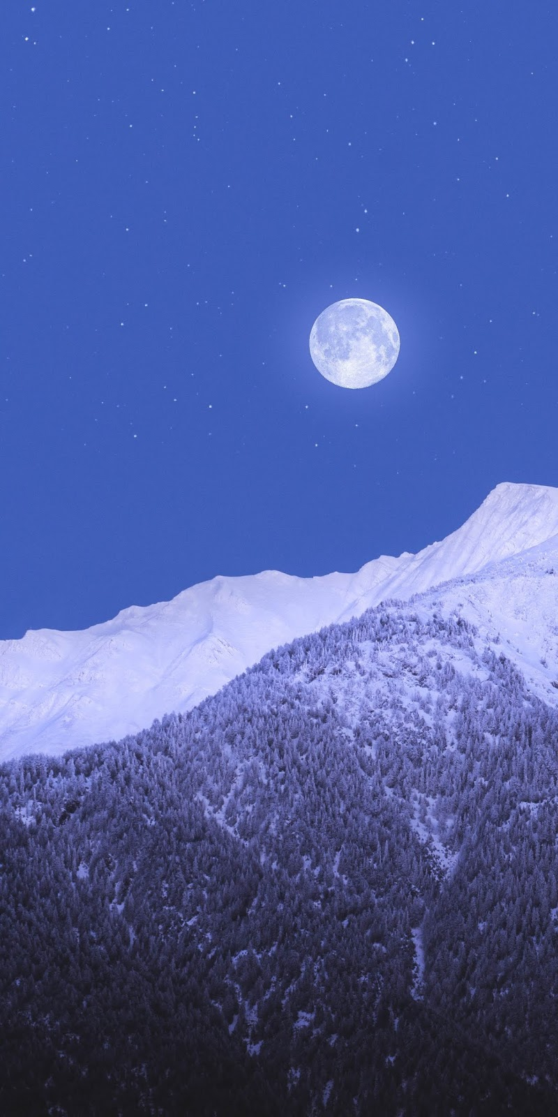 Full moon in the snowy mountain