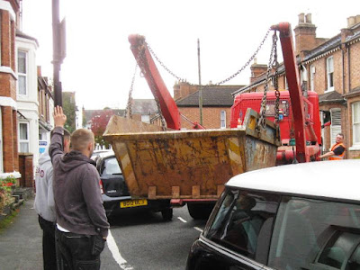 Lorry delivering skip guided by Sons of Ulf