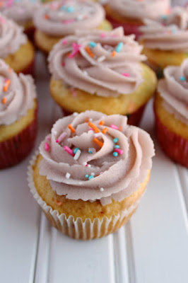 cupcakes decorated with sugar cookie dough frosting and cute sprinkles