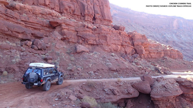 Jeep driving down rock trail