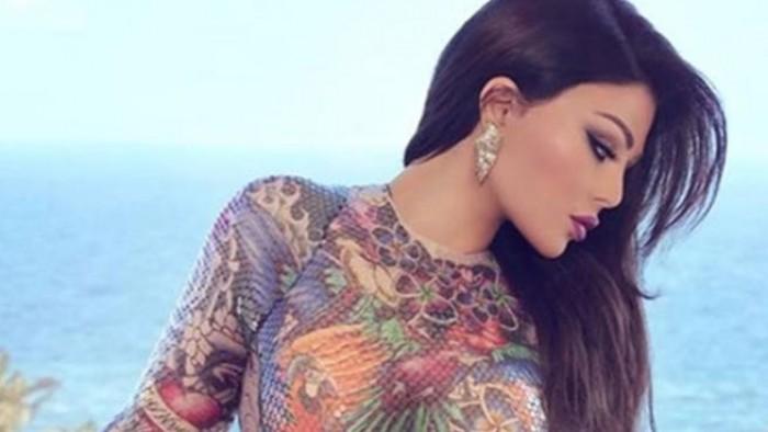 بعد أزمة رانيا يوسف بسبب فستانها هيفاء وهبى تُثير الجدل بفستان فاضح جداا وهكذا رد عليها المتابعين صور