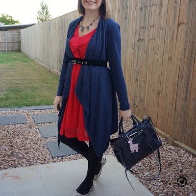 awayfromblue Instagram | navy waterfall belted cardigan over berry ruffle dress with rebecca minkoff regan bag and printed flats