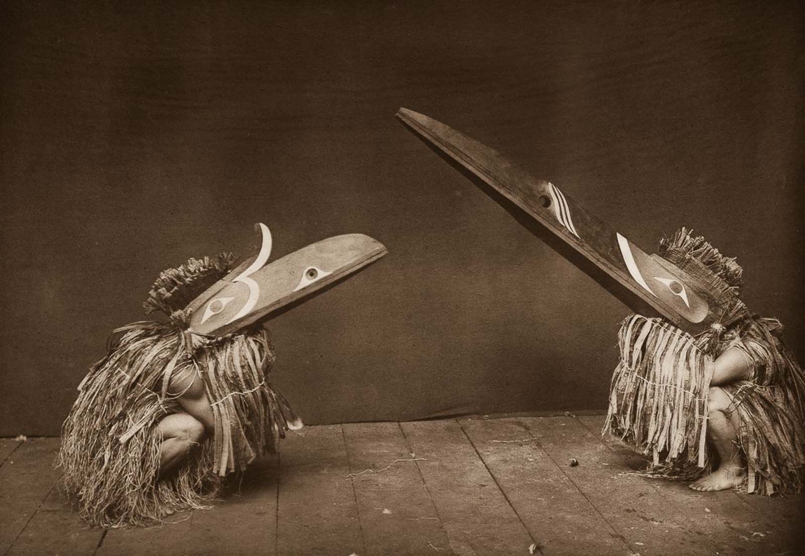 Nakoaktok dancers wear Hamatsa masks in a ritual. 1914.