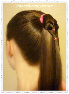 Cute heart hairstyle.  Hanging heart ponytail.