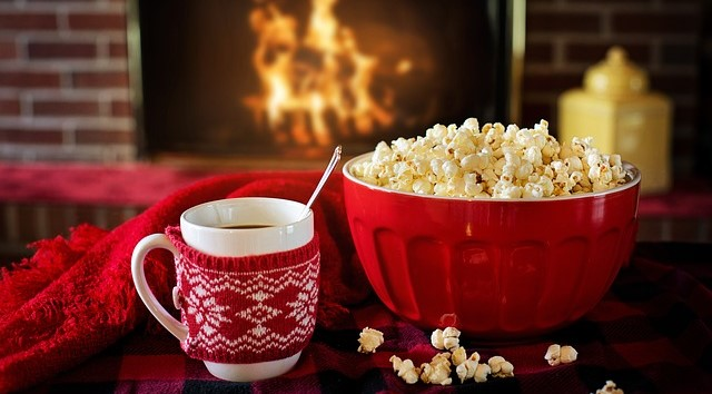 Bowl of Popcorn and Mug of Hot Cocoa in Front of the Fire