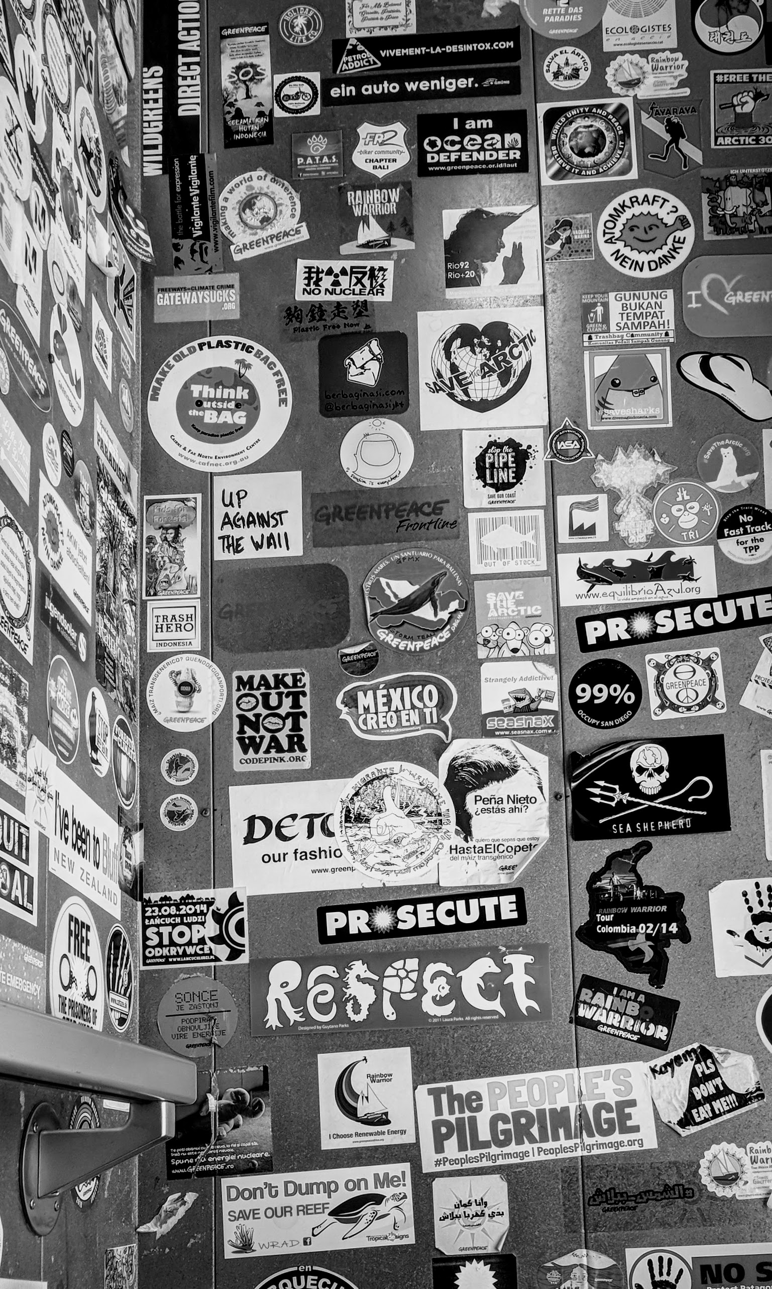 Protest stickers from around the world as seen in the Rainbow Warrior