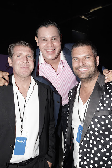 Former black man Sammy Sosa stands next to two white men and...