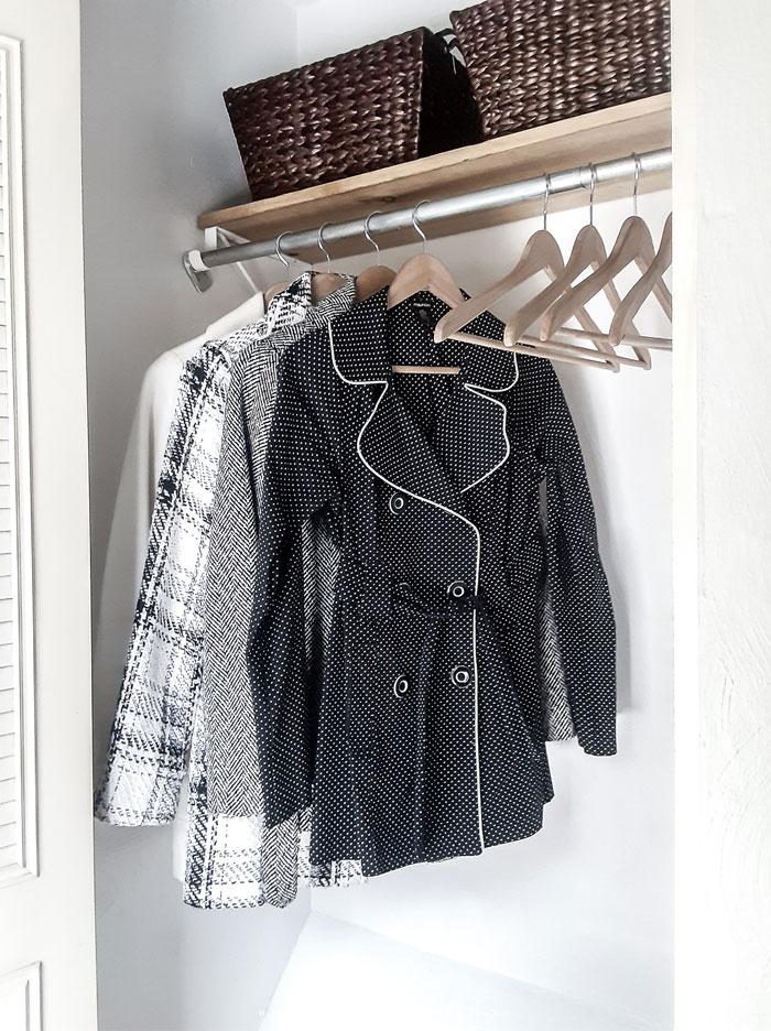 Coats hanging in white closet