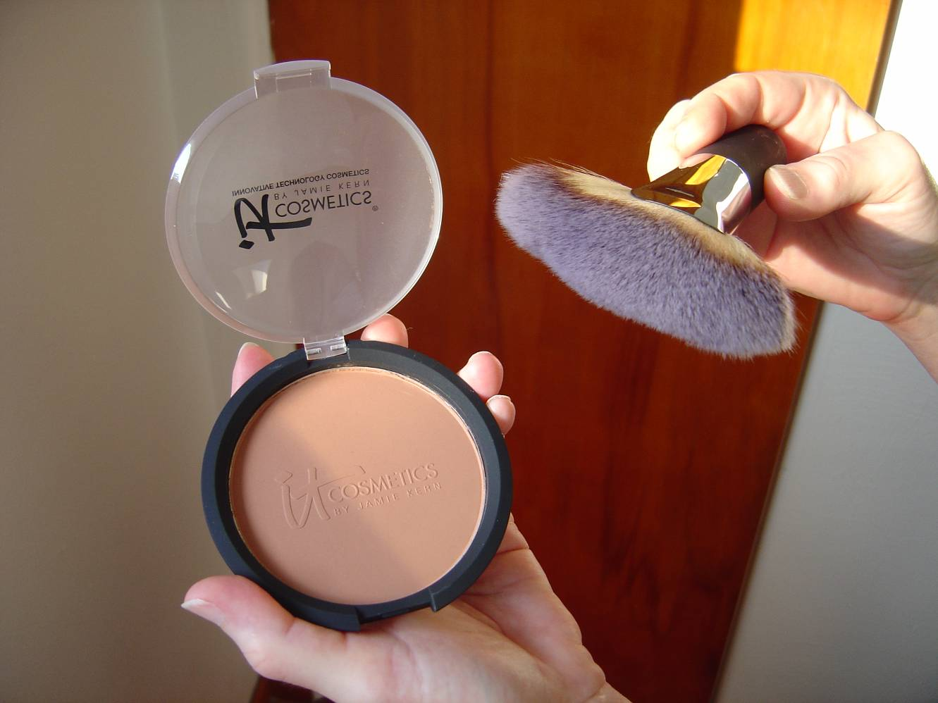 IT Cosmetics Vitality Glow Anti-Aging Matte Bronzer and the Heavenly Luxe Mega Fan Brush at different angle.jpeg