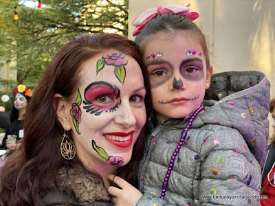 faces painted for the Day of the Dead/Dia de los Muertos festival in San Antonio, Texas