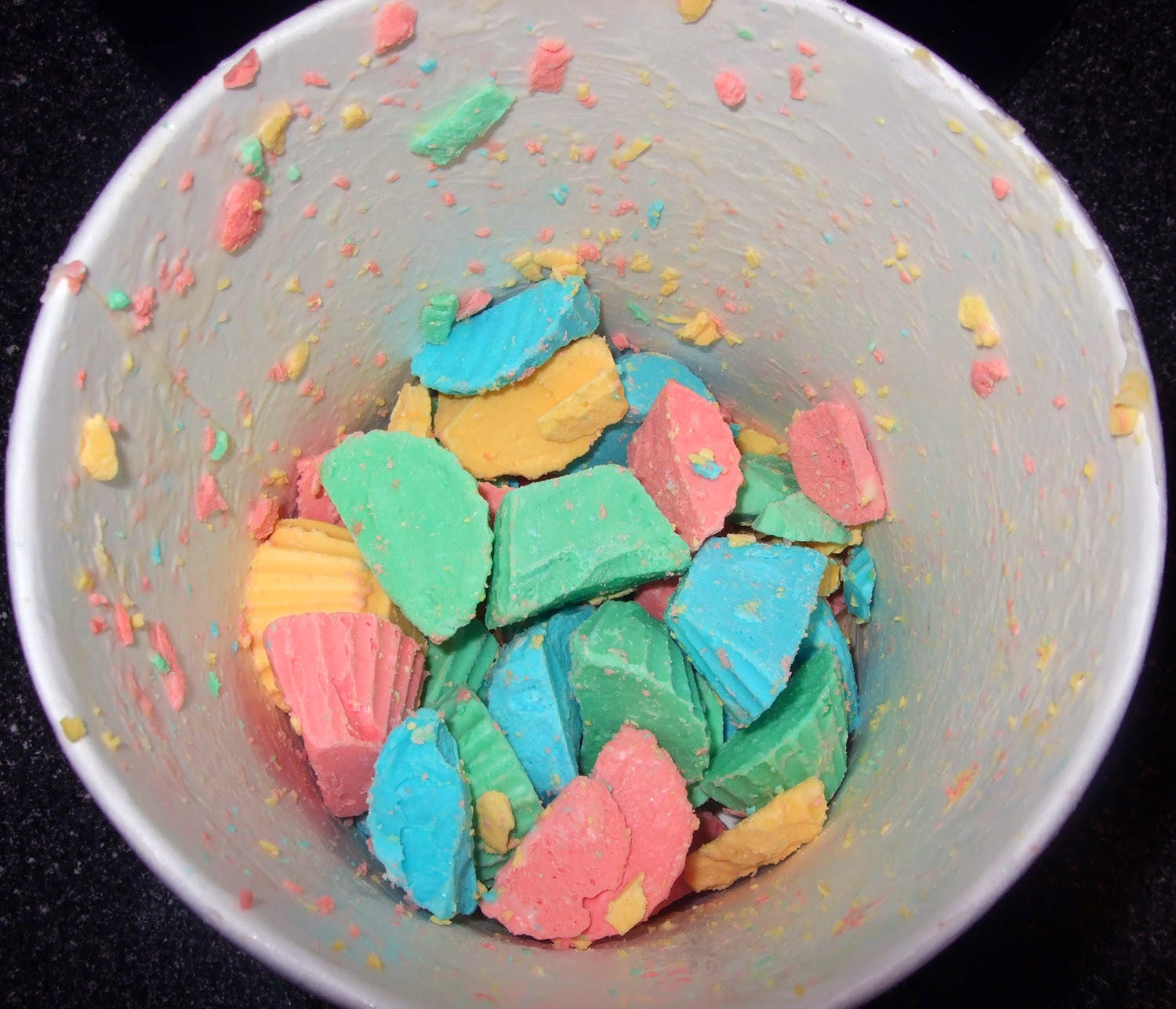 Cut up frosting bombs in ice cream container.