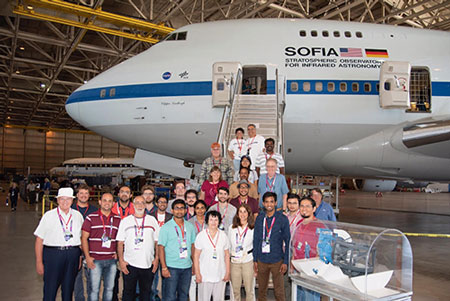 COSPAR attendee group picture after tour of SOFIA in Palmdale, CA (Source: NASA tour in Palmdale)