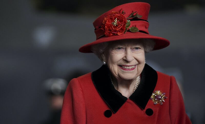Queen Elizabeth wore a red coat, gold diamond brooch. HMS Queen Elizabeth and sister aircraft carrier HMS Prince of Wales