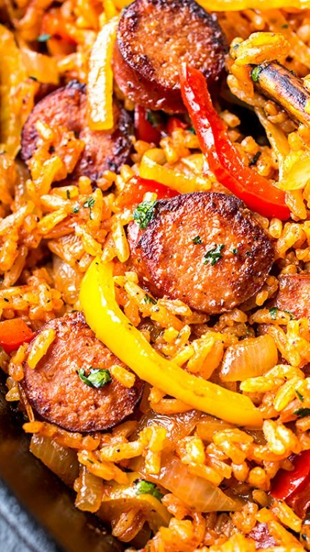 Smoked Sausage and Red Rice Skillet with Charred Onions and Peppers #recipes #dinnerrecipes #easyrecipes #neweasyrecipes #easydinnerrecipes #easyrecipesfordinner #neweasyrecipesfordinner #food #foodporn #healthy #yummy #instafood #foodie #delicious #dinner #breakfast #dessert #yum #lunch #vegan #cake #eatclean #homemade #diet #healthyfood #cleaneating #foodstagram
