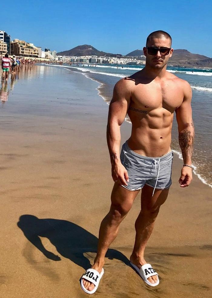 barechest-fit-beach-tattoo-dudes-sunglasses-wide-shoulders-abs-pecs-strong-legs-thighs