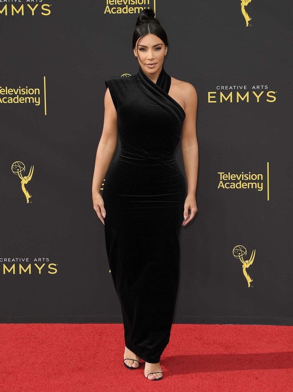 Kim Kardashian is a vision as she keeps it CLASSY in a black gown for the Creative Arts Emmys