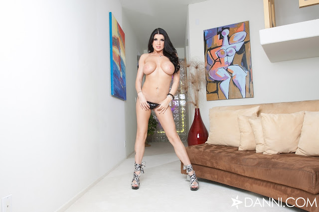 Romi Rain standing hot with naked boobs hands on panties
