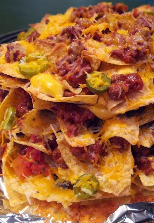Layered Nachos with Black Beans, Jalapenos, Rotel, and Lots of Cheese