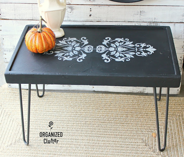 Photo of coffee table upcycled with paint and damask stencil