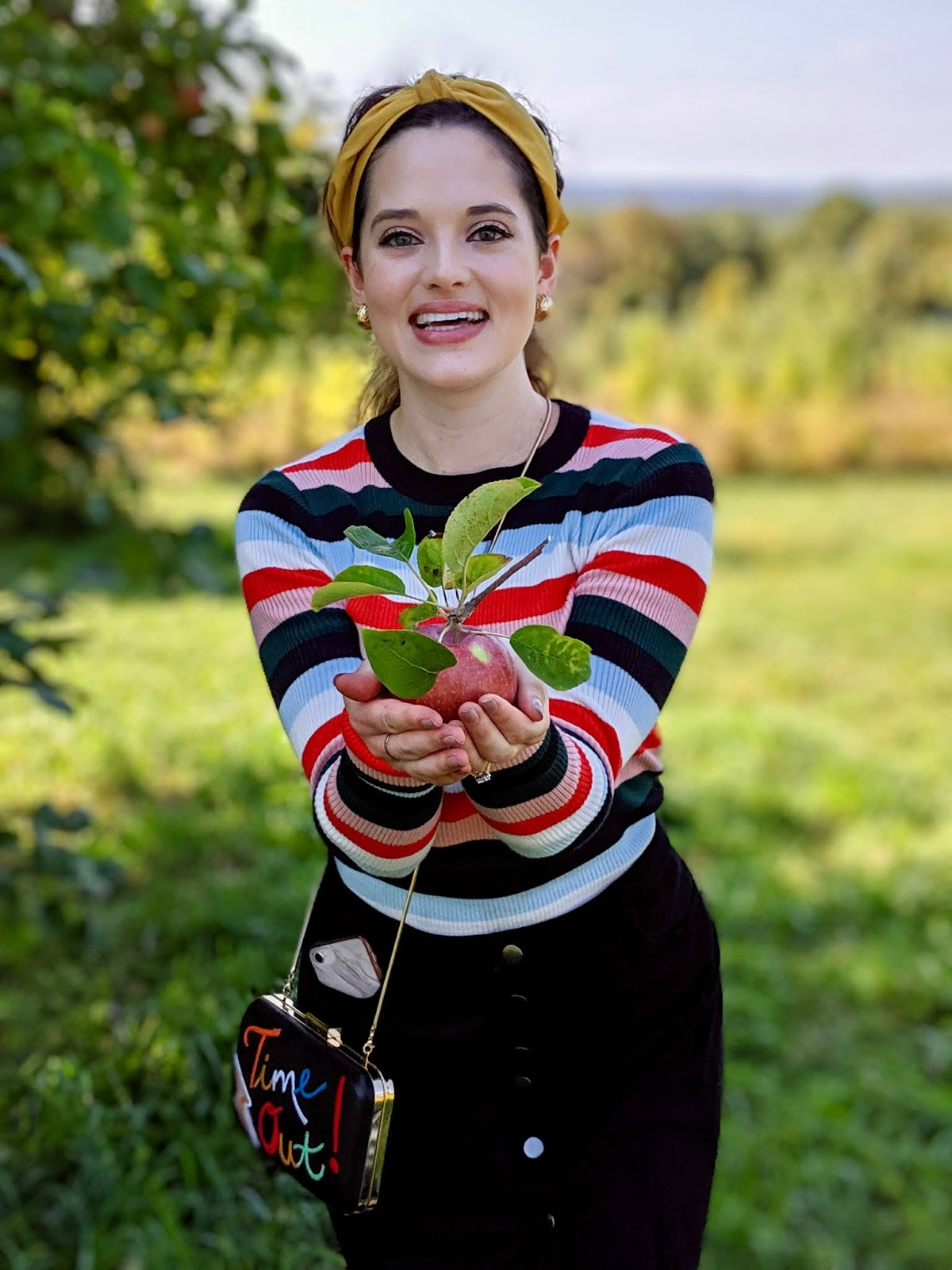 Nyc fashion blogger Kathleen Harper apple picking in the fall at Wilkens Fruit and Fir Farm.