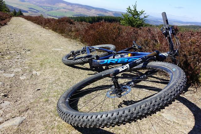 Isla Short national elite XC MTB racer having a break during training in the Scottish Borders.