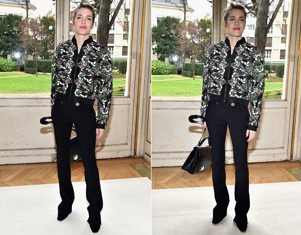 Charlotte Casiraghi at Paris Fashion Week show. Charlotte Casiraghi wore Giambattista Valli Macramé Lace Bomber Jacket and carried Giambattista Valli bags
