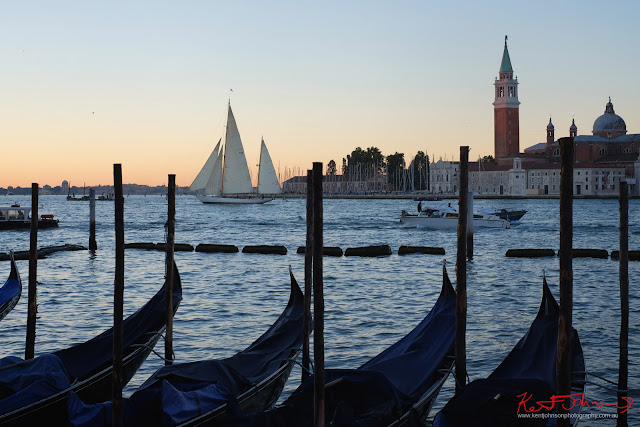 A sailing boat and gondolas on the Grand Canal, Venice Italy - Photograph  by Kent Johnson.