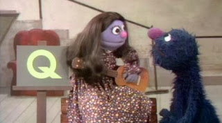 a little girl sings The Question Song with Grover about the letter Q. Sesame Street Alphabet Songs