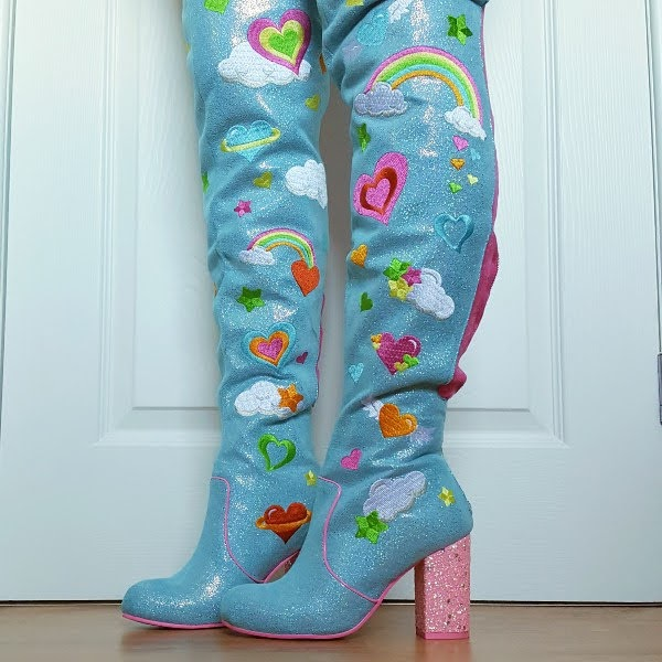 wearing blue thigh high boots with pink glitter heel