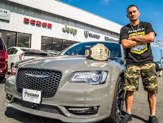 Kaimana's ex-husband Max posing for photo with a car