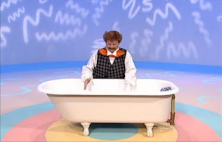 What does Mr. Noodle need to take a bath. He sees a bathtub full of water. Sesame Street Elmo's World Bath Time The Noodle Family