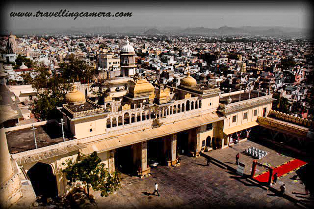 "I visited Udaipur with family a few years back. It was part of a larger itinerary that started with Jaipur, Ajmer, Pushkar, Chittorgarh, and Udaipur. Udaipur was the last stop and a perfect culmination to our trip.  I had booked two lake-view rooms in the Hanuman Ghat Area, which had a very Paharganj-like feel to it. I remember one funny incident. My family is used to having rusks with the morning tea, so I along with my cousins, went out to buy them. I kept asking the shopkeeper for rusks, and he kept showing me various types of juices. Then I spotted a packet of rusks and pointed at it. At this he laughed and said ""oh toasts?"" So now I know if I need rusks in Rajasthan, what I should ask for.       Anyway, coming back to Udaipur, it is a multilayered experience. Pretty, crowded, historical, modern, culturally-rich, actually it is a perfect slice of Rajasthan and in particular Mewar. Add to it some spices of its own that make it unique, and you have Udaipur, one of the most interesting cities in India.       Best time to Visit: Because the rest of the year can be so hot here in Rajasthan, Winter is the best time to visit most parts of the state. This is also the time when most of the festivals are held and when the streets are most lively with tourists. This is also the time when the stay options are likely to be most expensive, so book in advance. And don't forget to carry woollens as the nights can be chilly.       How to get there: Let's first talk about how to get here. We took a hired a Toyota Qualis from Pushkar to Udaipur, via Chittorgarh, Eklingji, Nathdwara, and Haldighati. Seeing Haldighati had been a long-time dream of my father. It was so gratifying to see him relishing the drive through the yellow hills so much. He had also always wanted to see Chittorgarh, and was simply delighted to be there. I will talk about Chittorgarh in another post in details.       By Road - You could either do what we did, as detailed above. Or you could plan a drive from Delhi or Mumbai, stopping en route for one night, if only one of you is driving. Or simply book yourself a comfortable night bus.       By Train - If you are travelling in from Delhi and looking for luxury and hospitality on train, you can book your place on the Palace on Wheels. That can be an experience in itself. Or you can book a train from any major city in India. Udaipur is well connected to Delhi, Mumbai, Kolkata.       By Air - The closest airport to Udaipur is the Maharana Pratap Airport, which is about 22 kilometers from the city. One can board flights from all major cities in India. Once you land, a taxi should be easy to book.       Where to Stay: There are several 5-star hotels where you can stay if you are willing to spend a fortune - The Oberai Udai Vilas, the Taj Palace, and the Leela Palace are just some of them. However, you can also opt for other good hotels that offer decent lake-facing rooms and are pocket-friendly too. We opted for such an option, and were pretty satisfied too.       Good accommodation is available starting from a few 100 Rs to whatever you want to spend on your stay. The best location is around Lake Pichola and you can find backpacker friendly accommodations such as dormitories too. Or if you are looking at a more culturally rich experience, you could opt for one of the Havelis converted to a hotel.        What to Eat: Typical Rajasthani food can be spicy, so be watchful of your tolerance and experiment accordingly. If you are in Udaipur, definitely try the traditional Rajasthani Thali. If you are non-vegetarian, you must taste Laal Maas as well. Gatta Curry and Daal Baati Choorma are Rajasthani specialties that one must try. Daal Baati Choorma can be heavy, so plan accordingly. Pyaaz Kachori, Samosas, and Jalebis are popular street foods in Udaipur.        What to See: The city of Udaipur is also known as the ""City of Lakes"" because of several large lakes inside and around the city. It also has several historical buildings, palaces and temples that you can visit. Here are some of the most popular places that you can plan during your trip:      The City Palace: The City Palace at Udaipur was built by Maharana Udai Mirza Singh in the 16th Century. It is perhaps the largest such palace in the whole of Rajasthan. Maharana Udai Mirza Singh is said to have got this built because he was instructed by a sage to do so at this very location. The palace is located on the banks of lake Pichola very near the Jagdish palace and can also be seen from the Monsoon Palace on the hill top. The Palace represents a fusion of the Rajasthani and Mughal style of construction and has been used as a location for various films. For example, the song ""Ghunghat ki aad se..."" from ""Hum hain rahi pyaar ke"" was shot in one of the courtyards of this palace. The lawns of the palace are now leased out for parties.      The Monsoon Palace: Also named as the Sajjan Garh Palace after Maharana Sajjan Singh, the Monsoon Palace was built on a hilltop to provide a view of the Monsoon clouds. I am not sure how much it is used for that purpose now, but it definitely provides a panoramic view of the Udaipur City. The drive to the palace is pleasant through a wild-life sanctuary, which is a reserve for reptiles, tigers, nilgai, sambhar, wild boars, hyenas, panthers, and jackals. And, as expected, we did not see any of those during the ride. The Monsoon Palace is also the Sunset Point. When we visited, a quite crowd was waiting for the sun to set with their cameras ready on the Tripods. It was a peaceful, safe, and beautiful place.      Lake Pichola: This is a man-made lake in the city and was created in the 15th century, then extended by Maharana Udai Singh II in the 16th century. This is really the most famous lake in the city. The various islands in the lake are home to more tourist attractions and around the lake are some of the most famous ghats and temples, and also accommodation options. So in a way, this is actually the center of the city. You can also go for a boat ride. If you want to see Jag Mandir then you anyway need to.       Jag Mandir / Jag Niwas: Jag Mandir and Jag Niwas were built in the 16th century on two separate natural islands in Lake Pichola. Jag Niwas has now been converted to the luxury hotel Lake Palace and is a luxury property owned by Taj hotels. It is said that Jag Mandir (or Lake Garden Palace) was the original inspiration behind Taj Mahal. Prince Khurram, who would later come to be known as Emperor Shahjahan, was inspired by this building when he was growing up.       Vintage Car Museum: Collecting vintage cars is a popular hobbies of the Maharajas of Rajasthan. This Vintage Car Museum is popular with car enthusiasts and is known for housing some really beautiful cars. The ticket for adults is Rs 250 per person.       Saheliyon ki Bari: This is a garden that Sangram Singh II gifted to his queen. It has beautiful lawns, fountains and Statues. However, after seeing City Palace, Monsoon Palace, this can be quite underwhelming. If short on time, you can skip visiting this place.         Jagdish Temple: The temple is located near the main market and you will almost certainly run into it if you happen to be in the city. The temple can be visited not only for the purposes of offering prayers but also for great architecture and carvings.       Places to Visit Around Udaipur: If you have some time, I would say that the following places can be explored:      Eklingji Temple: I remember reaching here early in the morning at around 9 and we had to wait for the temple complex to be opened to visitors. The temple opens very early at 4, but closes again at 7. It reopens then at 10. So we had to wait for an hour. But the wait was worth it. Apart from the main temple that has the statue of four-faced Shiva, there are several smaller temples and other structures in the complex. The architecture is marvelous. However, the tour is tightly regimented and photography is not allowed. So if you are going there for photography, then you need to rethink. The temple is about 40 kms from Udaipur.       Nathdwara (Shrinathji) Temple: We reached here one day before Holi and this being a temple dedicated to Lord Krishna, the atmosphere here was electric. There was color everywhere and if you happen to be a devotee, the sight might move you. It was difficult to get in, and the temple complex was unbelievably crowded. Crowds scare me, so I wanted to exit the scene as soon as possible, but for religious people, this is a must-visit. This is about an hour away from Udaipur and can be covered along with Eklingji.       Chittorgarh Fort via Haldighati: This can be a day-long excursion from Udaipur. The Fort is about 120 kms from Udaipur. You can also visit Haldighati along with this. This deserves a post of its own, so you will soon see it. The fort is simply beautiful, and must-visit in my opinion.     Kumbhalgarh Fort: I haven't been here, but have heard a lot about it. It is closer to Udaipur than Chittorgarh. I guess, with Chittorgarh, we have that added factor of legends that are associated with it, such as that of Rani Padmavati, so that adds to its charm. But Kumbhalgarh as well is very beautiful apparently.           I have personally experienced most of the aspects covered in this story, except a few where I have mentioned this explicitly. However, this was a few years back and things may have changed since then. So in case there are any corrections or additions, please do leave a comment here, and I would correct / include."