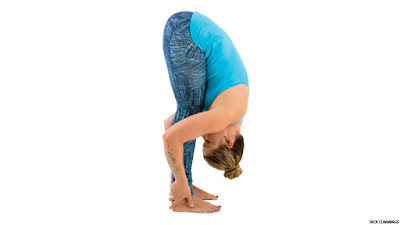 health  fitness magazine standing forward bend yoga pose