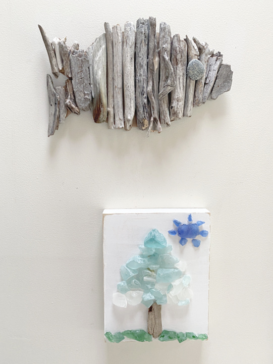 driftwood fish and sea glass picture on the wall