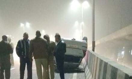 high speed car turn over at ajronda flyover in faridabad on tuesday foggy morning