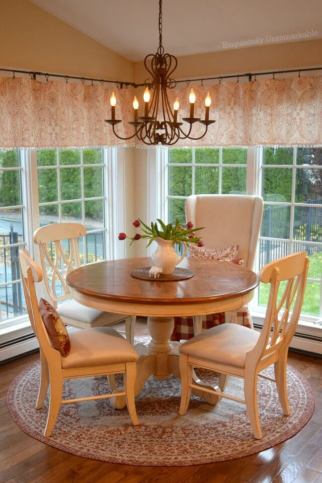 Red and White Cottage Style Dining Area with round table and round rug