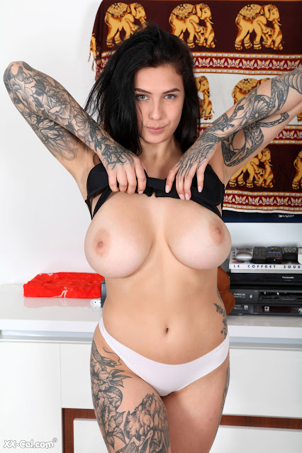 bustry tattoo model flashing her tits