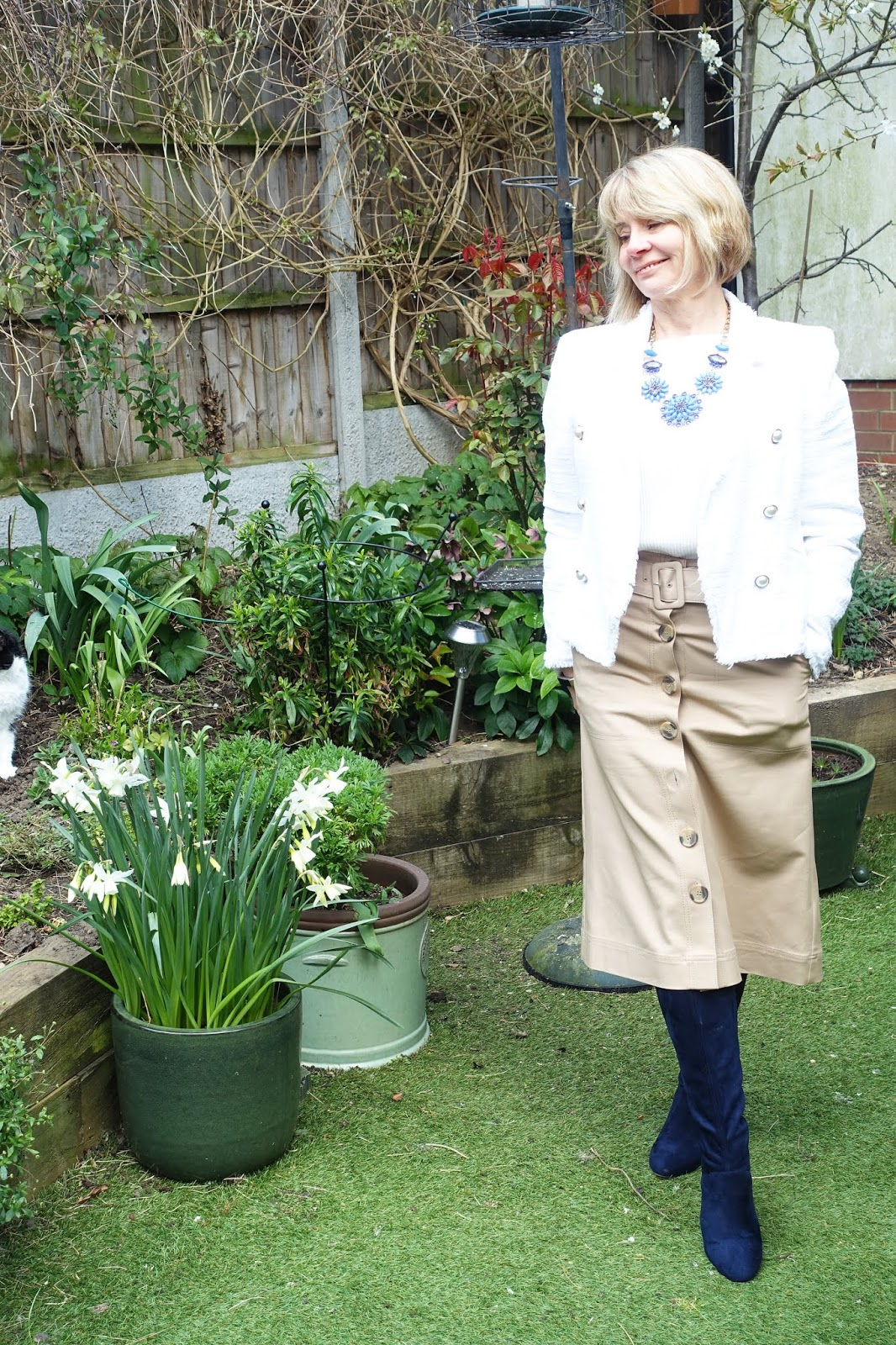 Coffee coloured midi skirt paired with navy and white