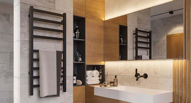 A heated towel rack in a large bathroom.